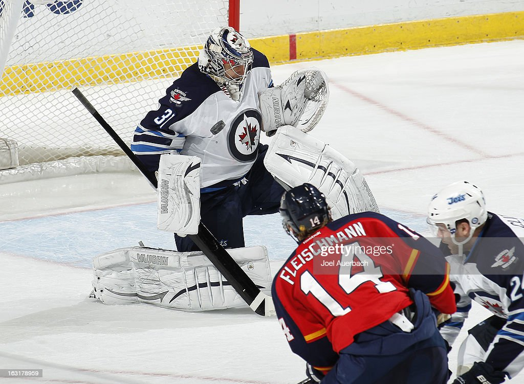 Goaltender Ondrej Pavelec #31 of the Winnipeg Jets stops a shot by <a gi-track='captionPersonalityLinkClicked' href=/galleries/search?phrase=Tomas+Fleischmann&family=editorial&specificpeople=554398 ng-click='$event.stopPropagation()'>Tomas Fleischmann</a> #14 of the Florida Panthers at the BB&T Center on March 5, 2013 in Sunrise, Florida. The Panthers defeated the Jets 4-1.