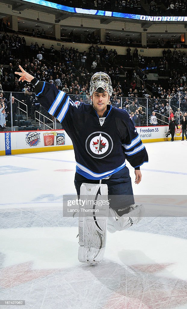 Goaltender Ondrej Pavelec #31 of the Winnipeg Jets waves to the crowd after receiving first star honors following a 5-0 shutout over the Nashville Predators at the MTS Centre on November 8, 2013 in Winnipeg, Manitoba, Canada.
