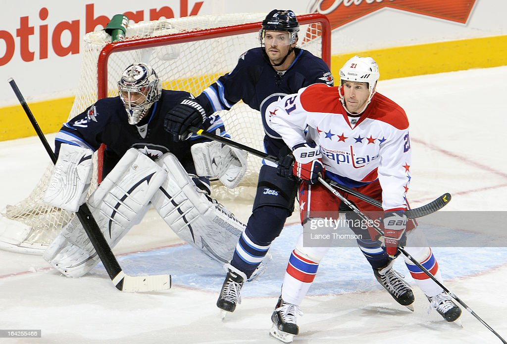 Goaltender Ondrej Pavelec #31, <a gi-track='captionPersonalityLinkClicked' href=/galleries/search?phrase=Ron+Hainsey&family=editorial&specificpeople=206345 ng-click='$event.stopPropagation()'>Ron Hainsey</a> #6 of the Winnipeg Jets and <a gi-track='captionPersonalityLinkClicked' href=/galleries/search?phrase=Brooks+Laich&family=editorial&specificpeople=554432 ng-click='$event.stopPropagation()'>Brooks Laich</a> #21 of the Washington Capitals keep an eye on the play during second-period action at the MTS Centre on March 21, 2013 in Winnipeg, Manitoba, Canada.