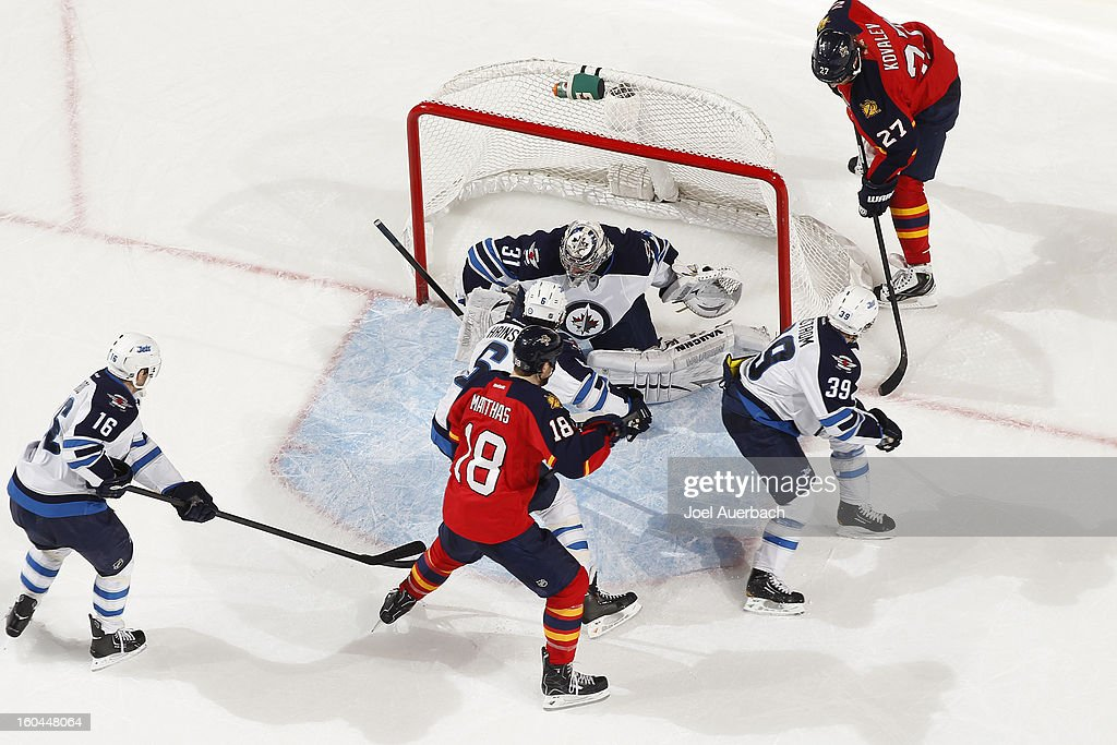 Goaltender <a gi-track='captionPersonalityLinkClicked' href=/galleries/search?phrase=Ondrej+Pavelec&family=editorial&specificpeople=3644118 ng-click='$event.stopPropagation()'>Ondrej Pavelec</a> #31of the Winnipeg Jets stops a shot by Shawn Matthias #18 of the Florida Panthers at the BB&T Center on January 31, 2013 in Sunrise, Florida. The Panthers defeated the Jets 6-3.