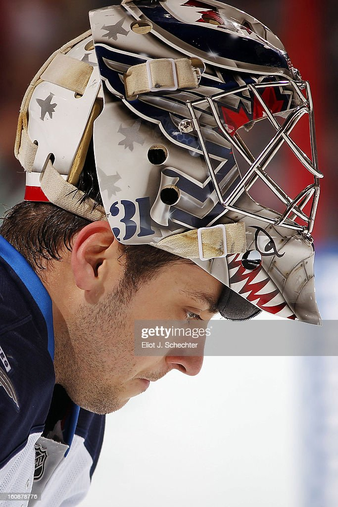 Goaltender Ondrej Pavelec #31of the Winnipeg Jets warms up on the ice prior to the start of the game against the Florida Panthers at the BB&T Center on January 31, 2013 in Sunrise, Florida.
