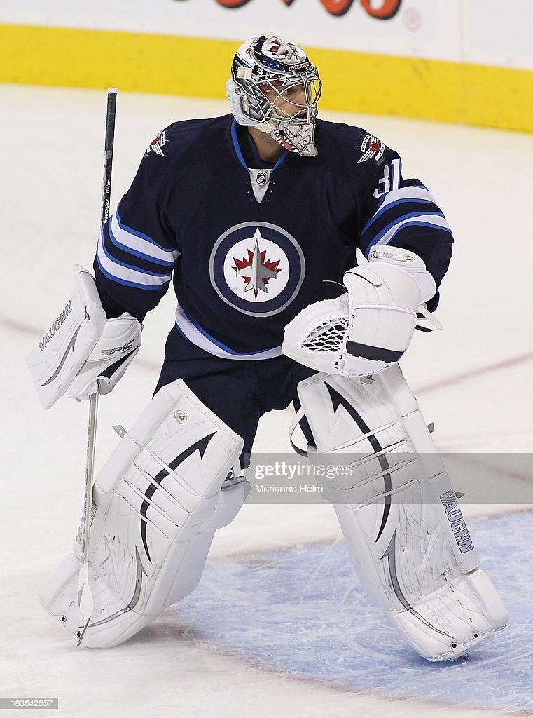 Goaltender Ondrej Pavelev #31 of the Winnipeg Jets looks around during warmup before an NHL preseason game against the Boston Bruins at the MTS Centre on September 26, 2013 in Winnipeg, Manitoba, Canada.