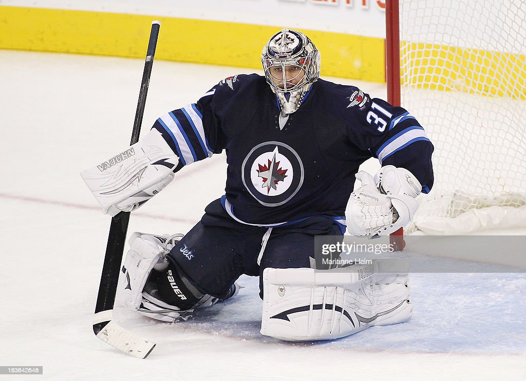 Goaltender Ondrej Pavelev #31 of the Winnipeg Jets protects his net in third period action during an NHL preseason game against the Boston Bruins at the MTS Centre on September 26, 2013 in Winnipeg, Manitoba, Canada.