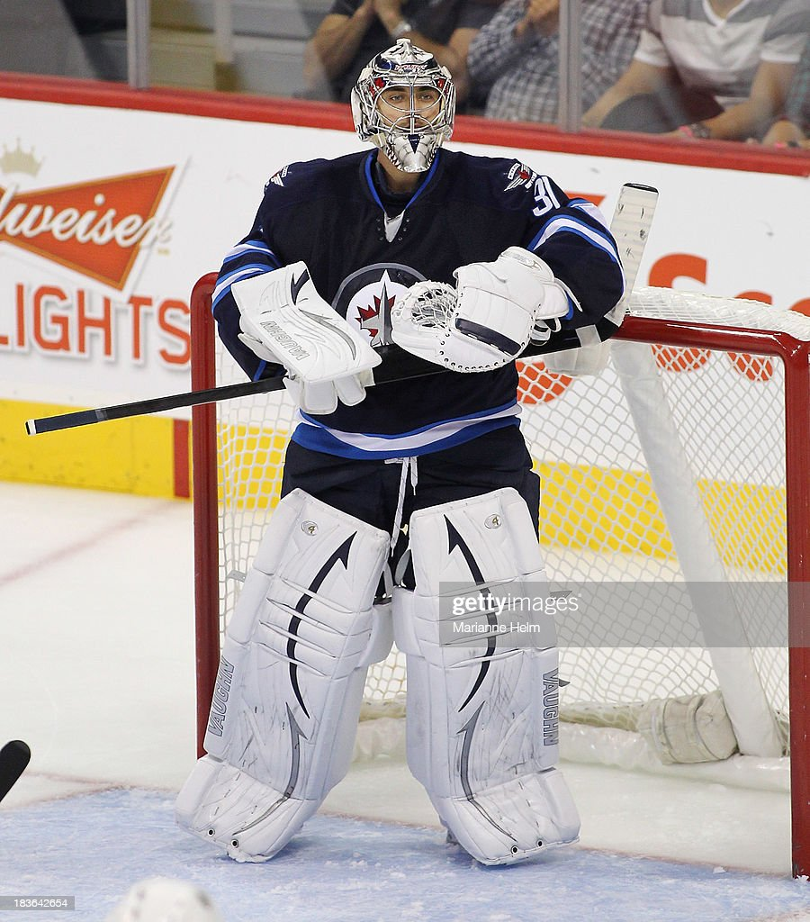 Goaltender Ondrej Pavelev #31 of the Winnipeg Jets stands in his net in third period action during an NHL preseason game against the Boston Bruins at the MTS Centre on September 26, 2013 in Winnipeg, Manitoba, Canada.