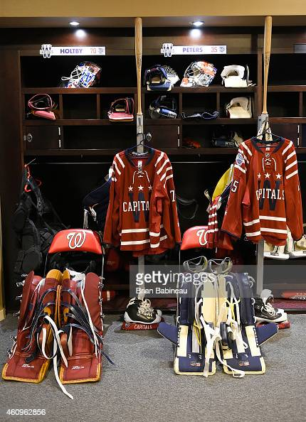 Goaltender pads of Braden Holtby and Justin Peters of the Washington Capitals are laid out in front of their locker room stalls prior to the 2015...