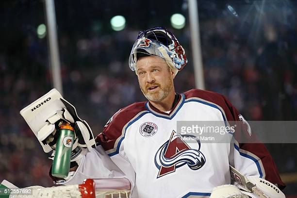 Goaltender Patrick Roy of the Colorado Avalanche Alumni team stands in goal during a break in the action against the Red Wings Alumni team at the...