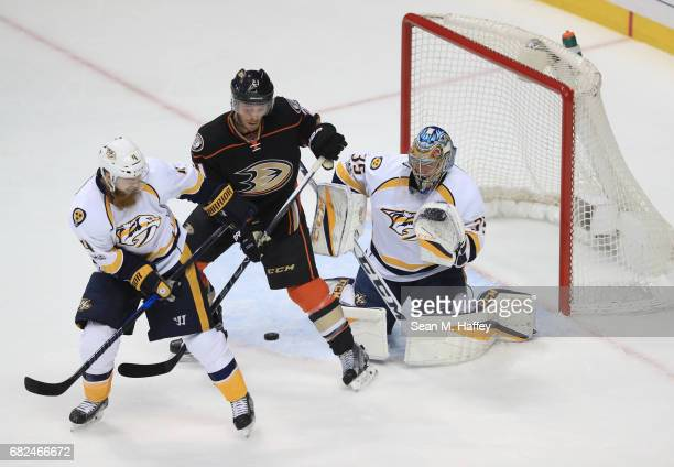 Goaltender Pekka Rinne and Ryan Ellis of the Nashville Predators defend the play against Chris Wagner of the Anaheim Ducks in the first period of...