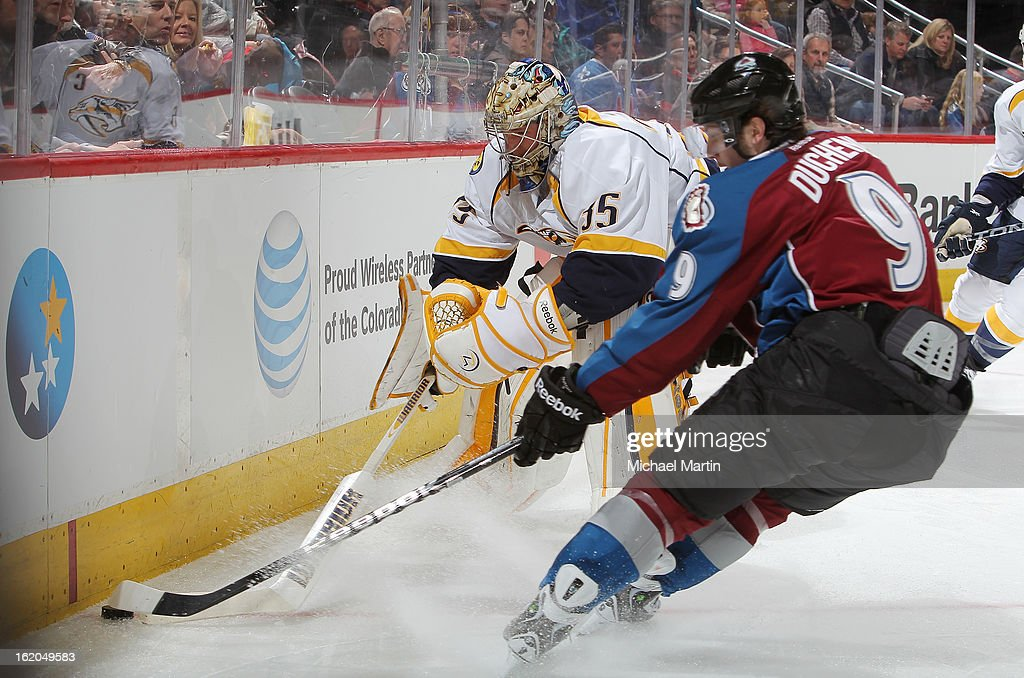 Goaltender <a gi-track='captionPersonalityLinkClicked' href=/galleries/search?phrase=Pekka+Rinne&family=editorial&specificpeople=2118342 ng-click='$event.stopPropagation()'>Pekka Rinne</a> #35 of the Nashville Predators clears teh puck against <a gi-track='captionPersonalityLinkClicked' href=/galleries/search?phrase=Matt+Duchene&family=editorial&specificpeople=4819304 ng-click='$event.stopPropagation()'>Matt Duchene</a> #9 of the Colorado Avalanche at the Pepsi Center on February 18, 2013 in Denver, Colorado. The Avalanche defeated the Predators 6-5.
