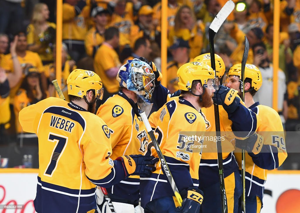 Goaltender Pekka Rinne #35 of the Nashville Predators is congratulated by teammates after they defeated the Pittsburgh Penguins 4-1 in Game Four of the 2017 NHL Stanley Cup Final at Bridgestone Arena on June 5, 2017 in Nashville, Tennessee.