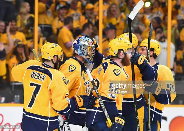 Goaltender Pekka Rinne of the Nashville Predators is congratulated by teammates after they defeated the Pittsburgh Penguins 41 in Game Four of the...