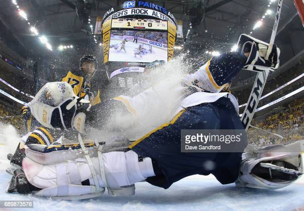 Goaltender Pekka Rinne of the Nashville Predators is sprayed with ice by Bryan Rust of the Pittsburgh Penguins during the first period of Game One of...
