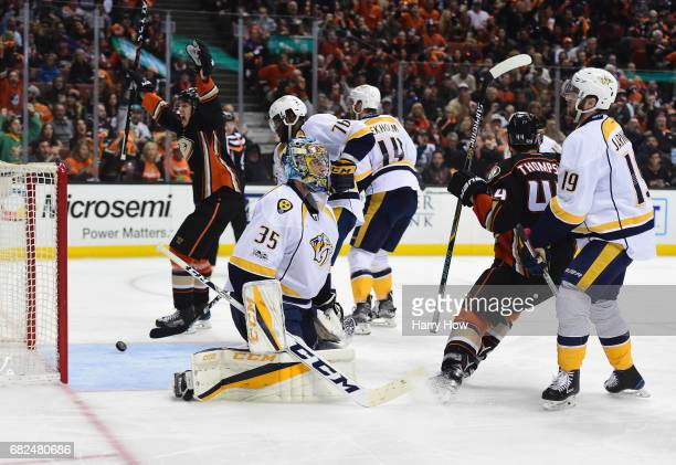 Goaltender Pekka Rinne of the Nashville Predators looks on as Rickard Rakell and Nate Thompson of the Anaheim Ducks react after a goal by Hampus...