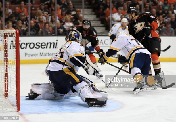 Goaltender Pekka Rinne of the Nashville Predators makes a pad save on a pointblank shot by Rickard Rakell of the Anaheim Ducks in the third period of...