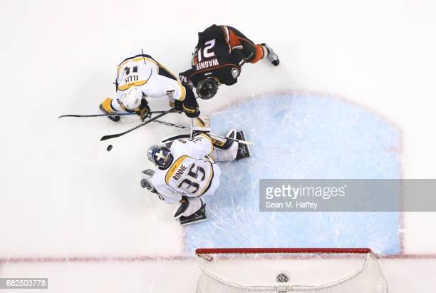 Goaltender Pekka Rinne of the Nashville Predators makes a save as Ryan Ellis of the Nashville Predators holds off Chris Wagner of the Anaheim Ducks...