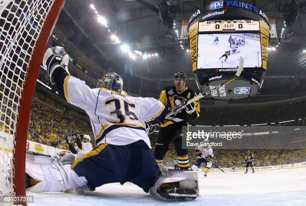 Goaltender Pekka Rinne of the Nashville Predators makes a save as Evgeni Malkin of the Pittsburgh Penguins looks on during the first period of Game...