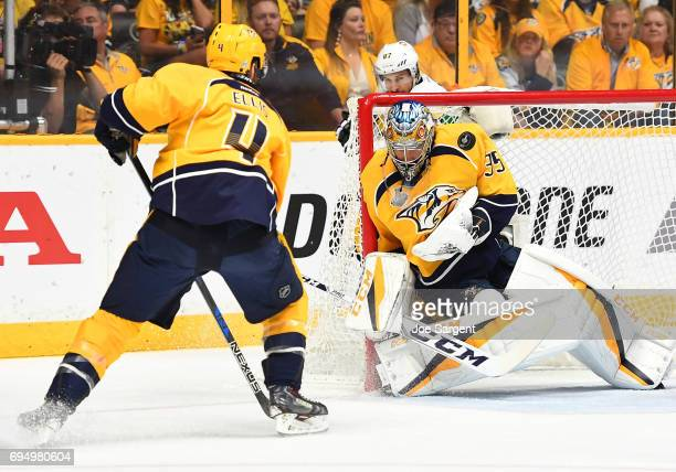 Goaltender Pekka Rinne of the Nashville Predators makes a save as Ryan Ellis of the Nashville Predators and Sidney Crosby of the Pittsburgh Penguins...