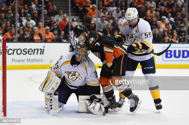 Goaltender Pekka Rinne of the Nashville Predators makes a save in front of Andrew Cogliano of the Anaheim Ducks and Roman Josi of the Nashville...