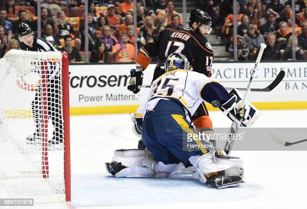 Goaltender Pekka Rinne of the Nashville Predators makes a save on a screened deflection by Ryan Kesler of the Anaheim Ducks in the first period of...