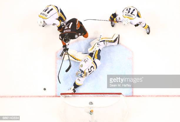 Goaltender Pekka Rinne of the Nashville Predators makes a save on Ryan Kesler of the Anaheim Ducks in the first period during Game Five of the...