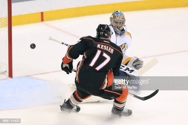 Goaltender Pekka Rinne of the Nashville Predators makes a save against Ryan Kesler of the Anaheim Ducks in the second period of Game Five of the...