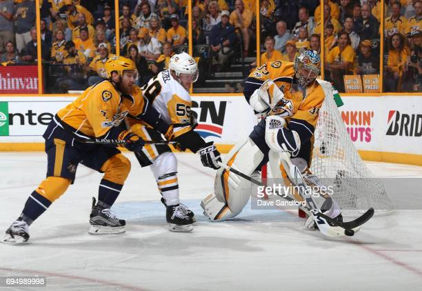 Goaltender Pekka Rinne of the Nashville Predators plays the puck as Yannick Weber pinches off Jake Guentzel of the Pittsburgh Penguins in the second...