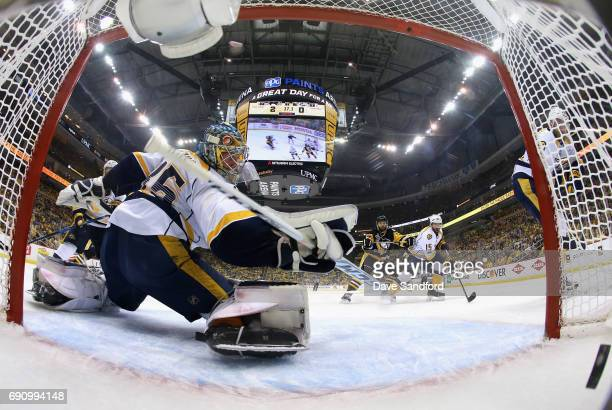 Goaltender Pekka Rinne of the Nashville Predators reaches back after a goal was scored by Nick Bonino of the Pittsburgh Penguins during the first...