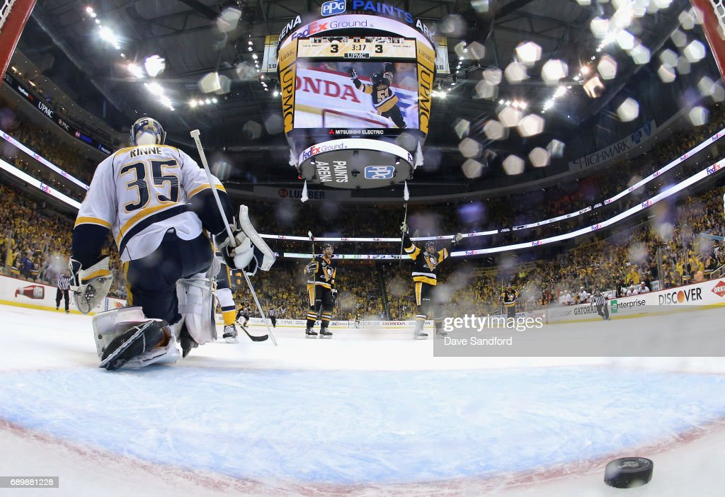 Goaltender Pekka Rinne #35 of the Nashville Predators reacts as the Pittsburgh Penguins celebrate the game-winning goal by Jake Guentze #59 (not pictured) during the third period of Game One of the 2017 NHL Stanley Cup Final at PPG Paints Arena on May 29, 2017 in Pittsburgh, Pennslyvannia. The Pittsburgh Penguins won the game 5-3.