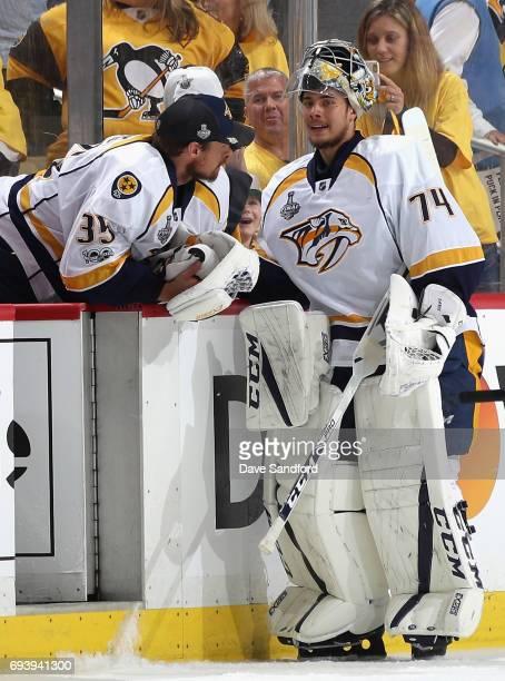 Goaltender Pekka Rinne of the Nashville Predators speaks to backup goaltender Juuse Saros during the second period of Game Five of the 2017 NHL...