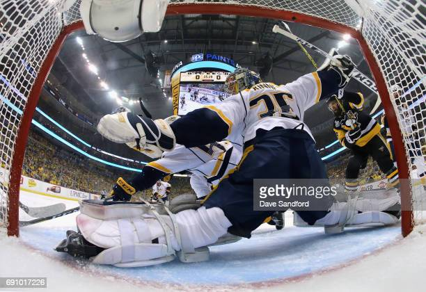Goaltender Pekka Rinne of the Nashville Predators stretches for a save as Nick Bonino of the Pittsburgh Penguins looks on during the first period of...