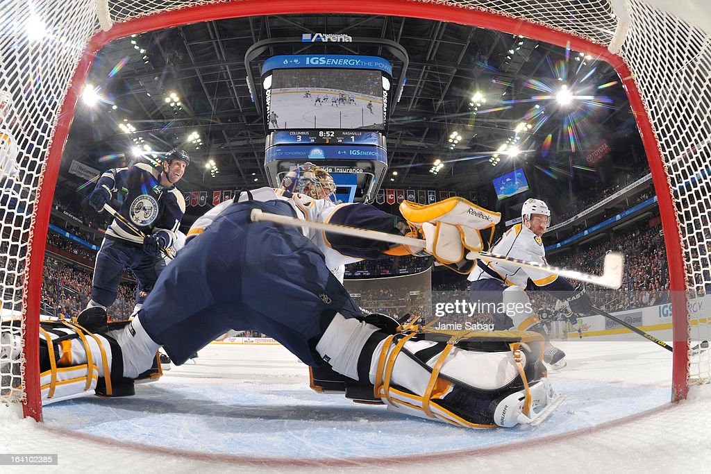 Goaltender <a gi-track='captionPersonalityLinkClicked' href=/galleries/search?phrase=Pekka+Rinne&family=editorial&specificpeople=2118342 ng-click='$event.stopPropagation()'>Pekka Rinne</a> #35 of the Nashville Predators stretches to defend the net as <a gi-track='captionPersonalityLinkClicked' href=/galleries/search?phrase=R.J.+Umberger&family=editorial&specificpeople=636608 ng-click='$event.stopPropagation()'>R.J. Umberger</a> #18 of the Columbus Blue Jackets skates by during the third period on March 19, 2013 at Nationwide Arena in Columbus, Ohio. Columbus defeated Nashville 4-3.
