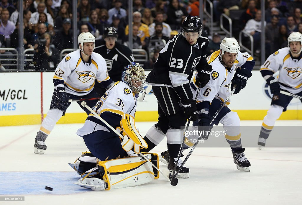 Goaltender Pekka Rinne #35 of the Nashville Predators watches the puck go wide, as Dustin Brown #23 of the Los Angeles Kings and Shea Weber #6 of the Nashville Predators pursue in the second period at Staples Center on January 31, 2013 in Los Angeles, California.