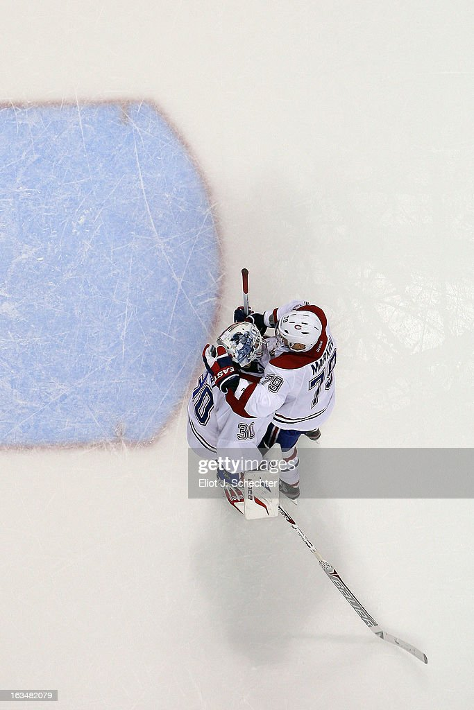 Goaltender <a gi-track='captionPersonalityLinkClicked' href=/galleries/search?phrase=Peter+Budaj&family=editorial&specificpeople=228123 ng-click='$event.stopPropagation()'>Peter Budaj</a> #30 of the Montreal Canadiens celebrates with teammate Andrei Markov #79 after beating the Florida Panthers 5-2 at the BB&T Center on March 10, 2013 in Sunrise, Florida.