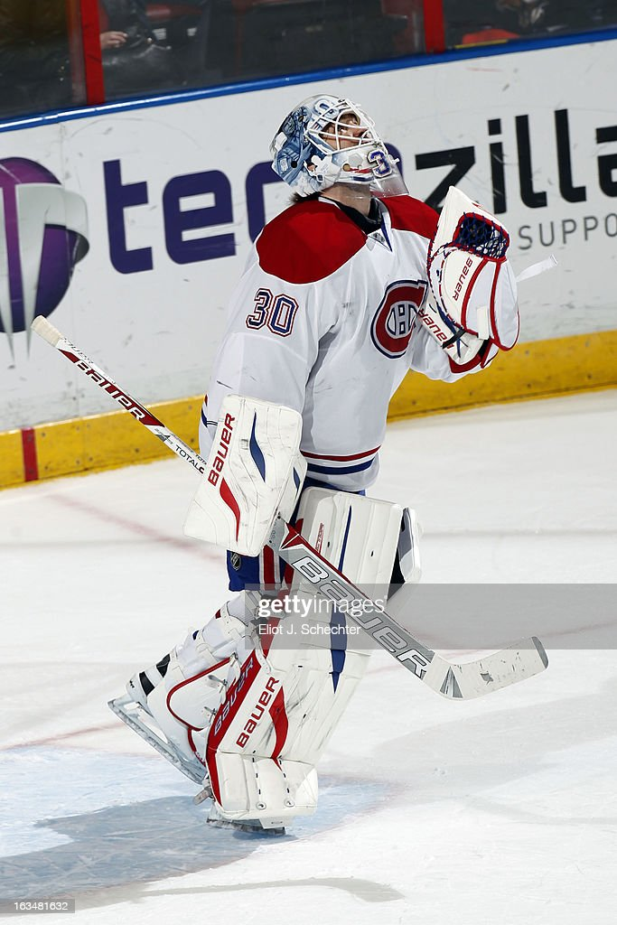 Goaltender <a gi-track='captionPersonalityLinkClicked' href=/galleries/search?phrase=Peter+Budaj&family=editorial&specificpeople=228123 ng-click='$event.stopPropagation()'>Peter Budaj</a> #30 of the Montreal Canadiens gives thanks after beating the Florida Panthers 5-2 at the BB&T Center on March 10, 2013 in Sunrise, Florida.