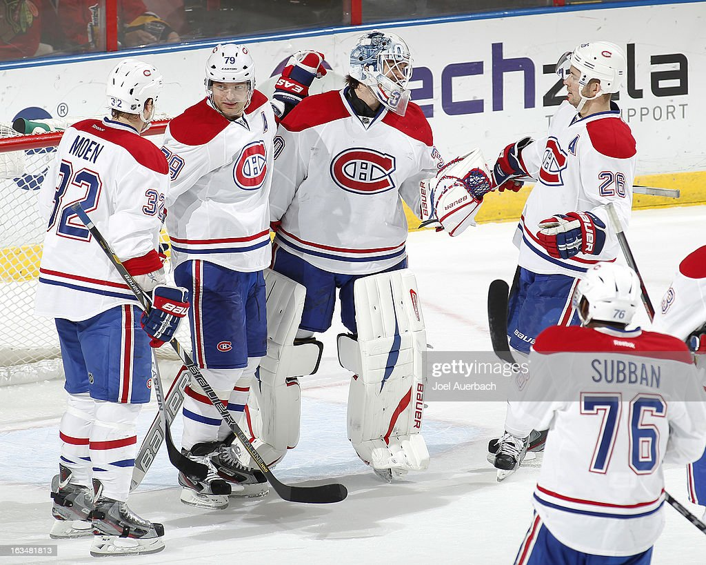 Goaltender <a gi-track='captionPersonalityLinkClicked' href=/galleries/search?phrase=Peter+Budaj&family=editorial&specificpeople=228123 ng-click='$event.stopPropagation()'>Peter Budaj</a> #30 of the Montreal Canadiens is congratulated by teammates after defeating the Florida Panthers at the BB&T Center on March 10, 2013 in Sunrise, Florida. The Canadiens defeated the Panthers 5-2.