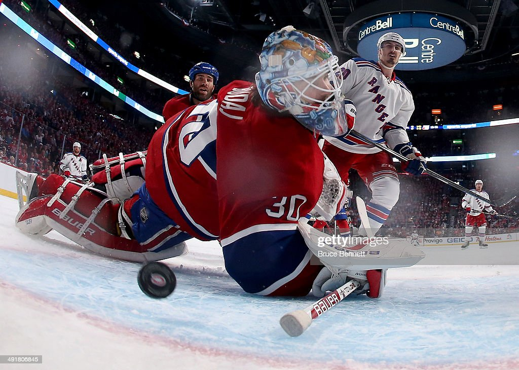 Goaltender <a gi-track='captionPersonalityLinkClicked' href=/galleries/search?phrase=Peter+Budaj&family=editorial&specificpeople=228123 ng-click='$event.stopPropagation()'>Peter Budaj</a> #30 of the Montreal Canadiens is unable to stop a goal by Derek Stepan #21 of the New York Rangers in the third period in Game One of the Eastern Conference Finals of the 2014 NHL Stanley Cup Playoffs at the Bell Centre on May 17, 2014 in Montreal, Canada.