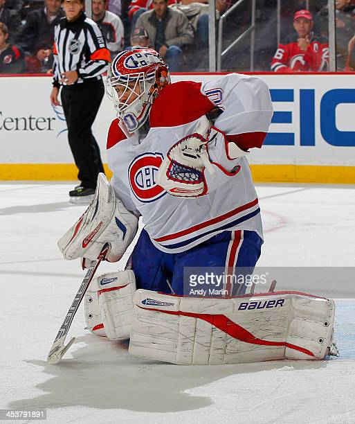 Goaltender Peter Budaj of the Montreal Canadiens makes a save against the New Jersey Devils during the game at the Prudential Center on December 4...