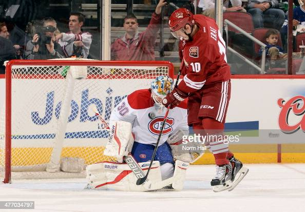 Goaltender Peter Budaj of the Montreal Canadiens makes a save on the redirected shot by Martin Erat of the Phoenix Coyotes during the first period at...