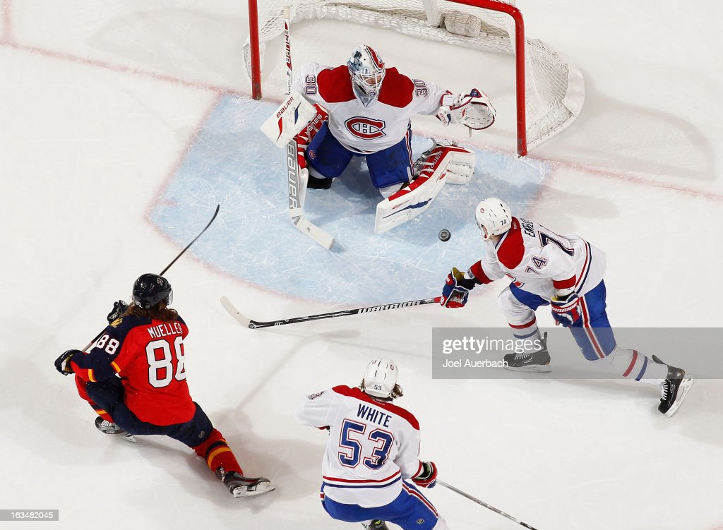 Goaltender <a gi-track='captionPersonalityLinkClicked' href=/galleries/search?phrase=Peter+Budaj&family=editorial&specificpeople=228123 ng-click='$event.stopPropagation()'>Peter Budaj</a> #30 of the Montreal Canadiens stops a second period shot by Peter Mueller #88 of the Florida Panthers at the BB&T Center on March 10, 2013 in Sunrise, Florida. The Canadiens defeated the Panthers 5-2.