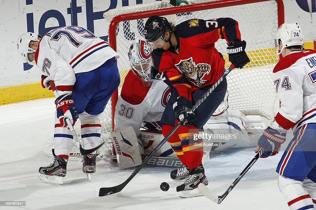 Goaltender Peter Budaj #30 of the Montreal Canadiens stops a third period shot by Kris Versteeg #32 of the Florida Panthers at the BB&T Center on March 10, 2013 in Sunrise, Florida. The Canadiens defeated the Panthers 5-2.