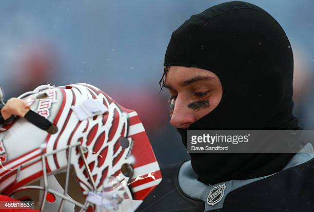 Goaltender Petr Mrazek of the Detroit Red Wings puts on his mask during the 2014 Bridgestone NHL Winter Classic team practice session on December 31...
