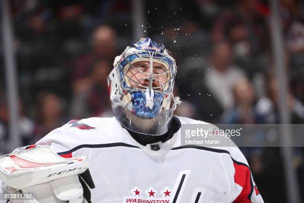 Goaltender Philipp Grubauer of the Washington Capitals expels water during a break in the action against the Colorado Avalanche at the Pepsi Center...