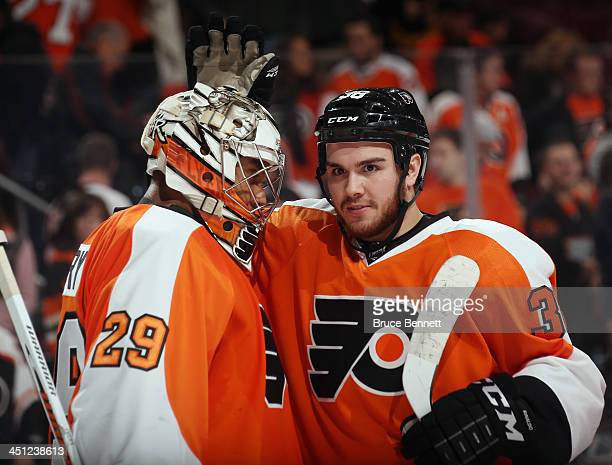Goaltender Ray Emery and Zac Rinaldo of the Philadelphia Flyers celebrate their 41 victory over the Buffalo Sabres at the Wells Fargo Center on...