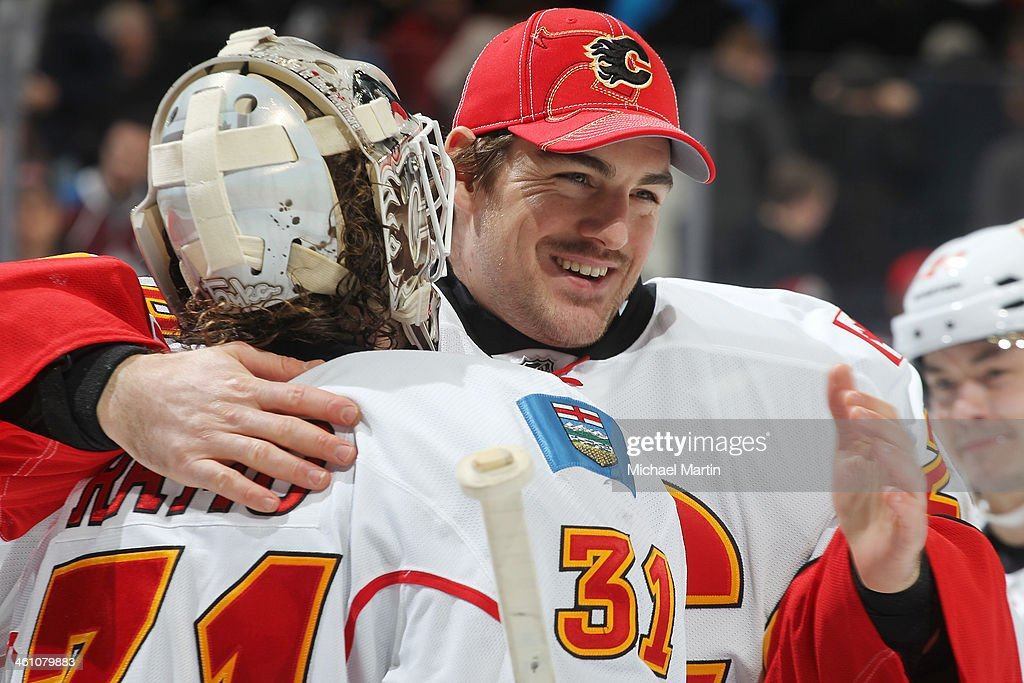 Goaltender Reto Berra #29 of the Calgary Flames congratulates fellow goaltender <a gi-track='captionPersonalityLinkClicked' href=/galleries/search?phrase=Karri+Ramo&family=editorial&specificpeople=716721 ng-click='$event.stopPropagation()'>Karri Ramo</a> #31 after a win against the Colorado Avalanche at the Pepsi Center on January 06, 2014 in Denver, Colorado. The Flames defeated the Avalanche 4-3. Ê