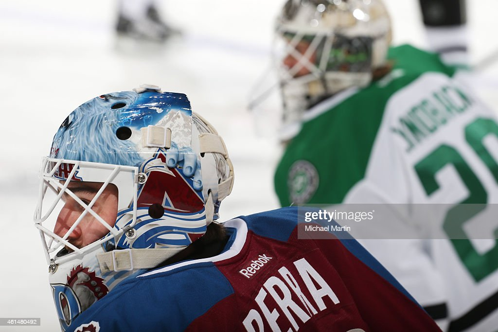 Goaltender Reto Berra of the Colorado Avalanche and goaltender Anders Lindback of the Dallas Stars stretch prior to the game at the Pepsi Center on...