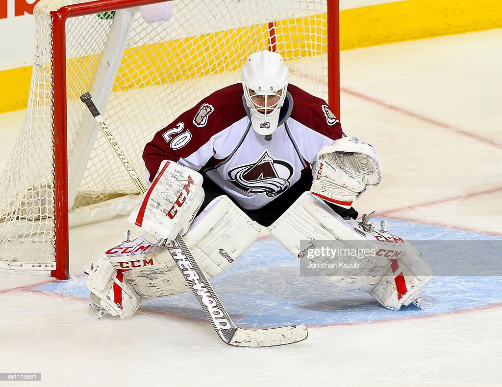 Goaltender Reto Berra of the Colorado Avalanche gets set in the crease during third period action against the Winnipeg Jets at the MTS Centre on...
