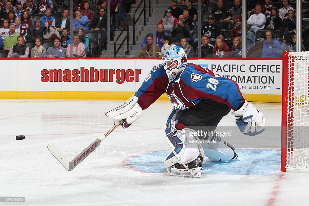 Goaltender Reto Berra of the Colorado Avalanche plays the puck against the Florida Panthers at the Pepsi Center on October 21 2014 in Denver Colorado