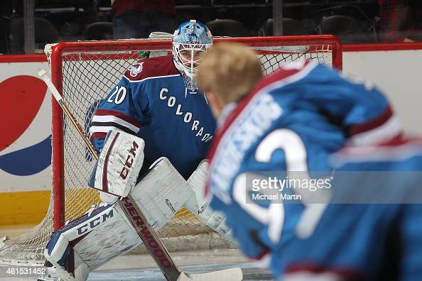 Goaltender Reto Berra of the Colorado Avalanche warms up with teammate Gabriel Landeskog prior to the game against the Ottawa Senators at the Pepsi...