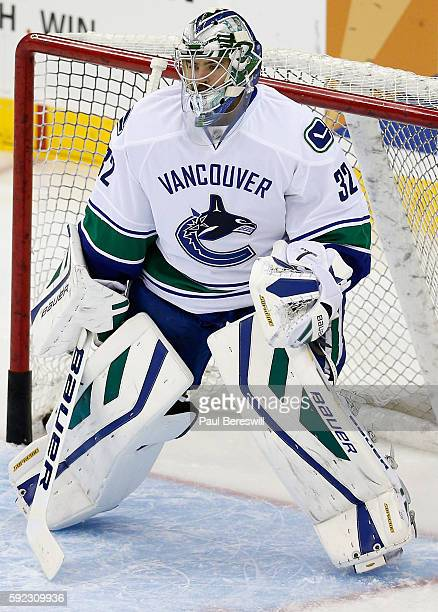 Goaltender Richard Bachman of the Vancouver Canucks plays in the game against the New Jersey Devils at the Prudential Center on November 8 2015 in...