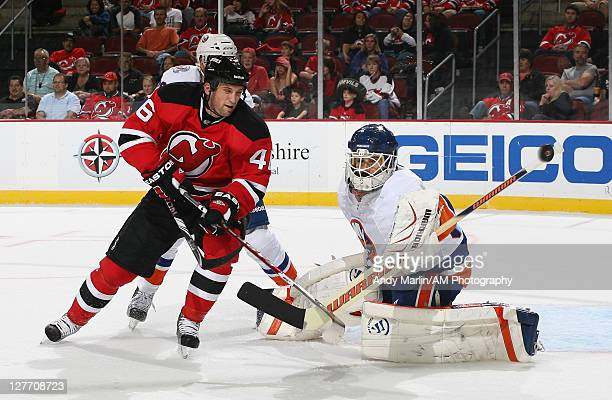 Goaltender Rick DiPietro of the New York Islanders makes a save on a point blank shot by Tim Sestito of the New Jersey Devils during the preseason...