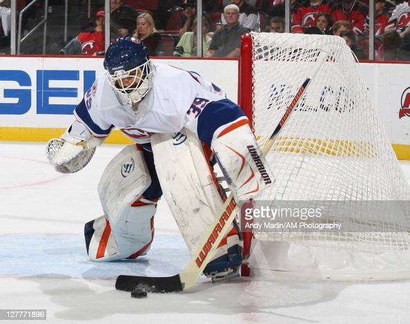 Goaltender Rick DiPietro of the New York Islanders makes a save against the New Jersey Devils during the preseason game on September 30 2011 at the...